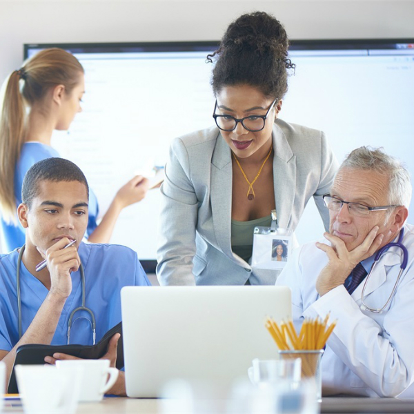Healthcare practitioners studying information a computer